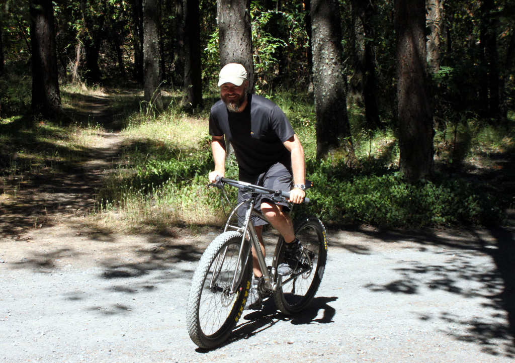 Tim cranking up the driveway on his new bike.
