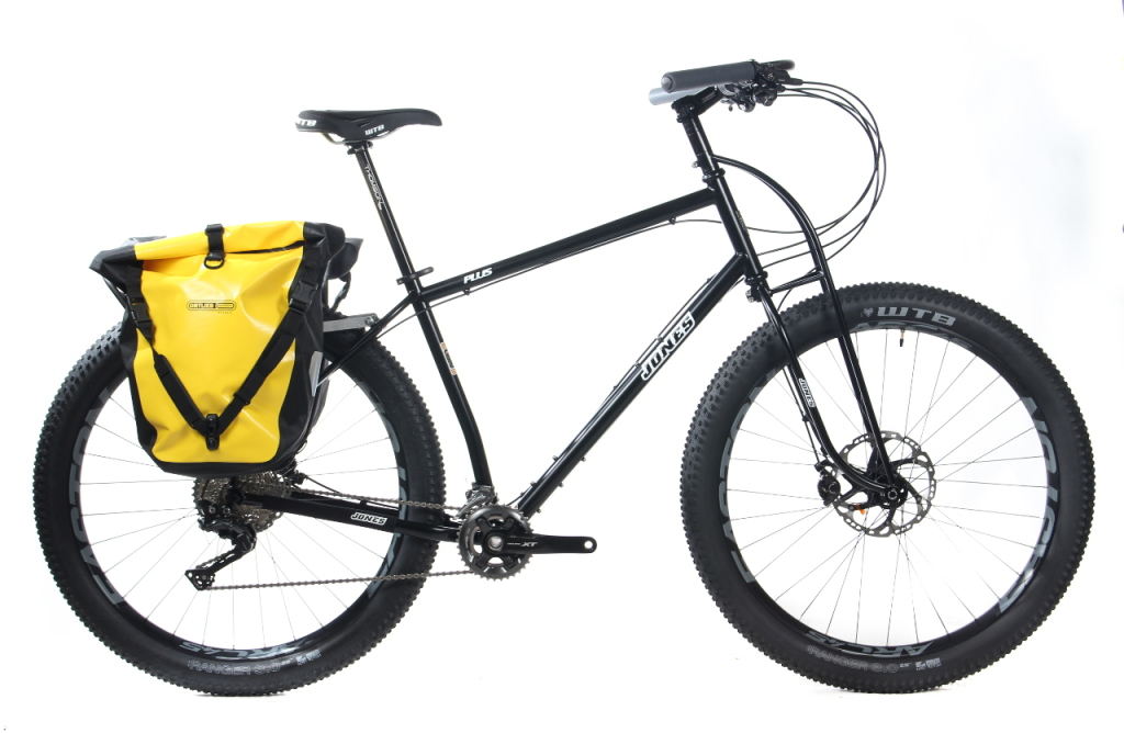 "25"" Plus 148, Shimano M8000 2x11 drivetrain and hydraulic brakes, carbon Loop H-Bar, Easton ARC+45 rims, WTB Ranger tires, Old Man Mountain Pioneer rack, Ortlieb Backroller panniers."