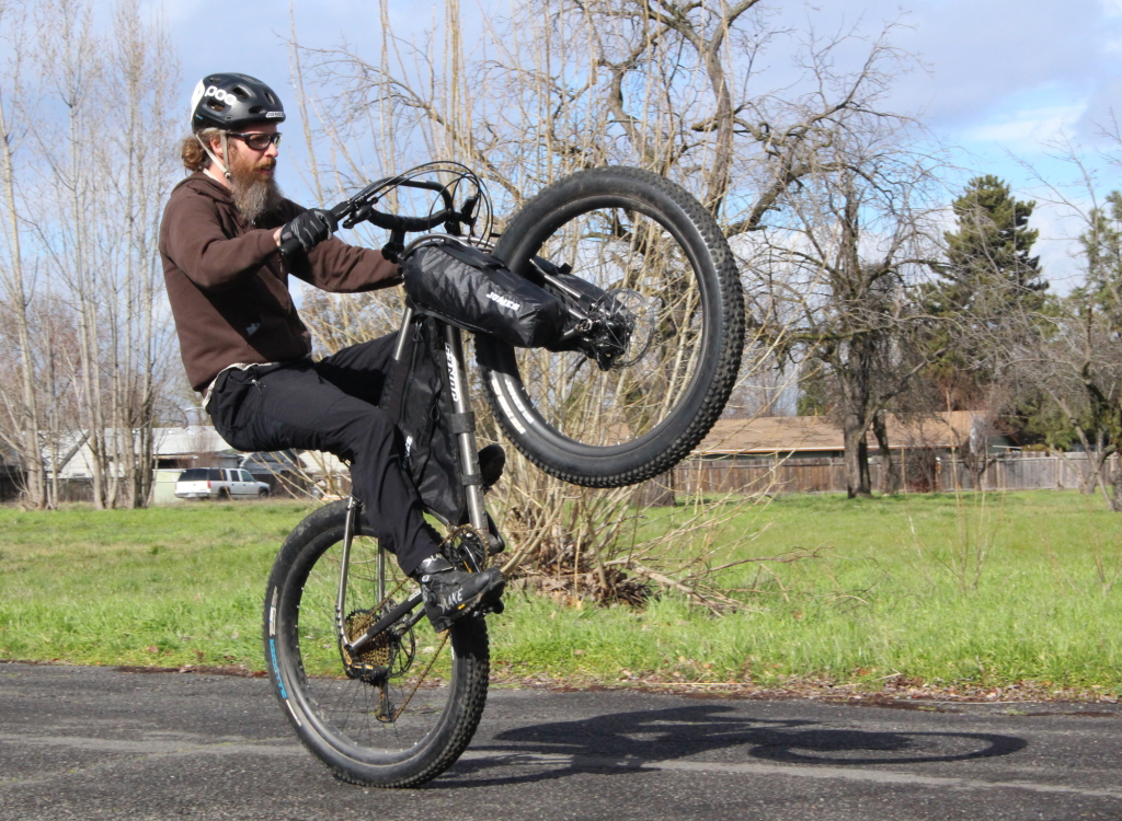 Yes you will still be able to wheelie your bike while using Truss Fork Packs.